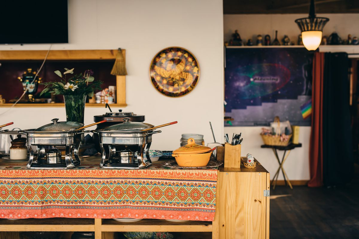 Chafing dishes and ceramic bowls laid out on the table for guests at Russian House #1 to help themselves