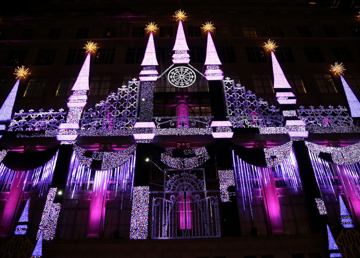 The exterior of Saks, lit up like a Disney castle