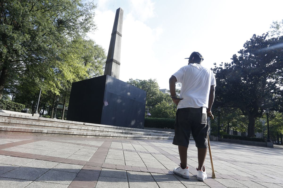 12 foot plywood wall surroundingConfederate monument in Birmingham, Alabama.