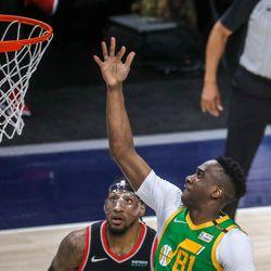 Utah Jazz guard guard Miye Oni (81) shoots over Portland Trail Blazer forward Robert Covington (23) during the game at Vivint Smart Home Arena in Salt Lake City on Thursday, April 8, 2021.