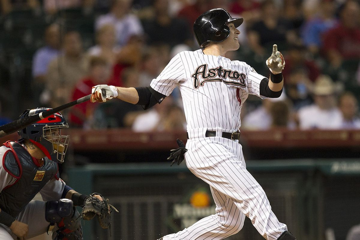 HOUSTON, TX - JUNE 07:  Jed Lowrie #4 of the Houston Astros hits a home run in the first inning against the St. Louis Cardinals on June 7, 2012 at Minute Maid Park in Houston, Texas.  (Photo by Bob Levey/Getty Images)