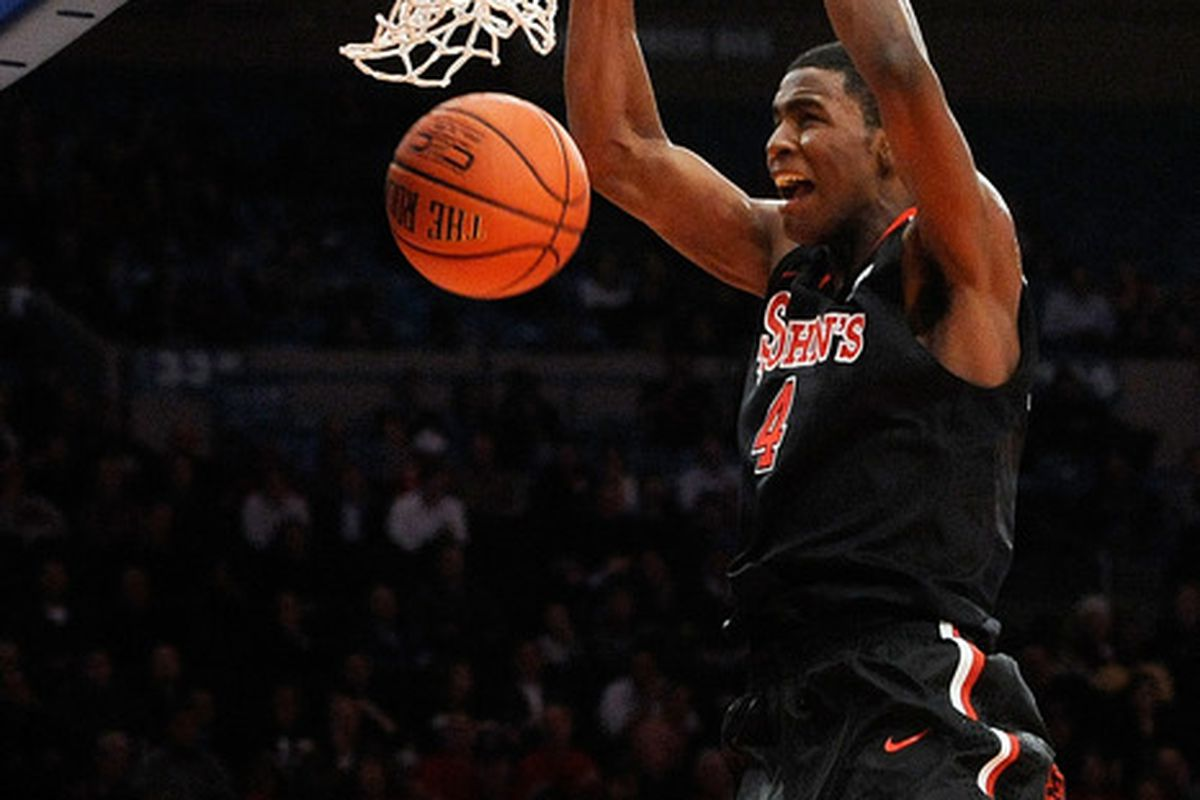 NEW YORK, NY - NOVEMBER 17:  Moe Harkless #4 of the St. John's Red Storm makes a dunk against Arizona Wildcats.  Moe is a freshman of the year candidate.  (Photo by Patrick McDermott/Getty Images)