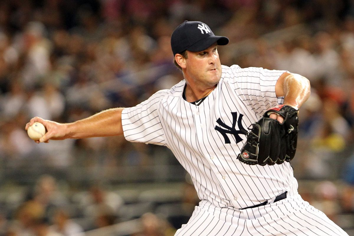 Aug 13, 2012; Bronx, NY, USA;  New York Yankees relief pitcher Derek Lowe (34) pitches during the sixth inning against the Texas Rangers at Yankee Stadium. Anthony Gruppuso-US PRESSWIRE