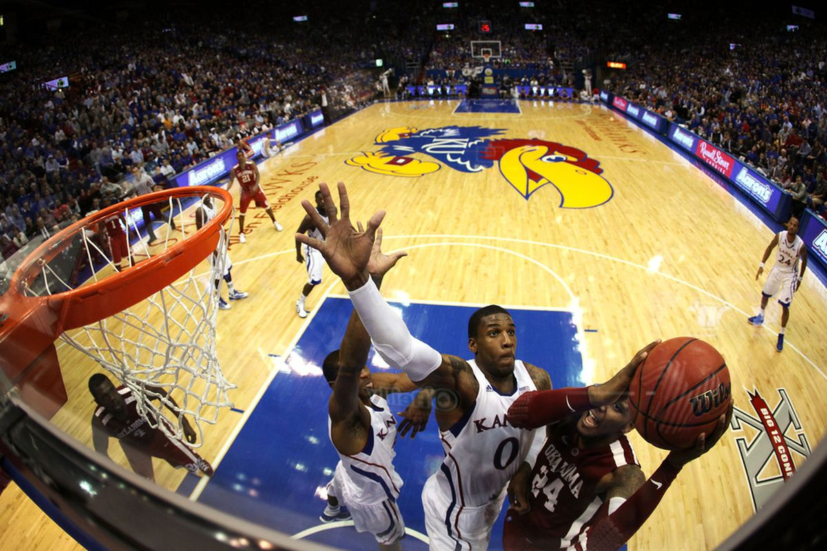 LAWRENCE, KS - FEBRUARY 01:  Romero Osby #24 of the Oklahoma Sooners shoots as Thomas Robinson #0 of the Kansas Jayhawks tries to block during the game on February 1, 2012 at Allen Fieldhouse in Lawrence, Kansas.  (Photo by Jamie Squire/Getty Images)