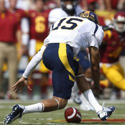 California quarterback Zach Maynard fumbles during the first half of an NCAA college football game against Southern California in Los Angeles, Saturday, Sept. 22, 2012.