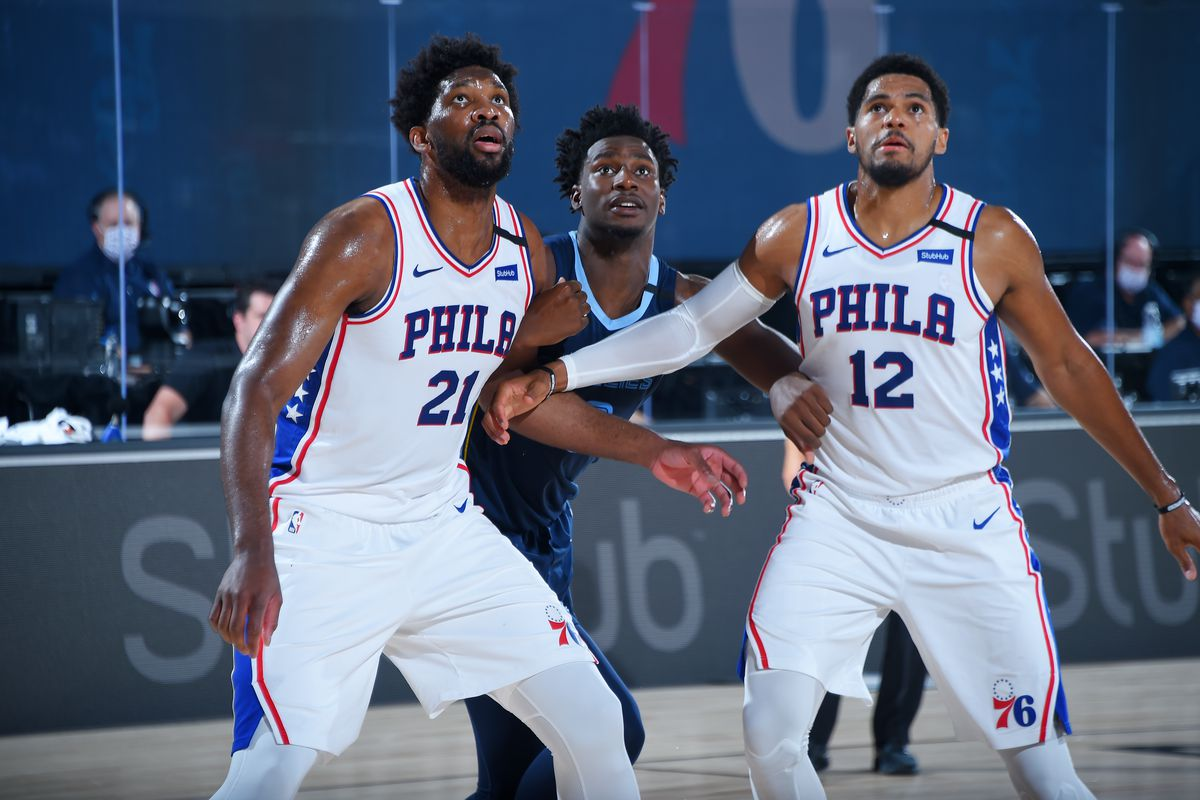 Joel Embiid of the Philadelphia 76ers, Jaren Jackson Jr. of the Memphis Grizzlies, Tobias Harris of the Philadelphia 76ers fight for the rebound during a scrimmage on July 24, 2020 at The Arena at ESPN Wide World of Sports in Orlando, Florida.