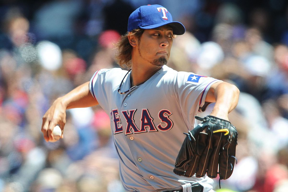 May 6, 2012; Cleveland, OH, USA: Texas Rangers starting pitcher Yu Darvish (11) throws a pitch in the first inning against the Cleveland Indians at Progressive Field.  Mandatory Credit: Eric P. Mull-USPRESSWIRE