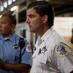 Lt. Paul Bauer, right and officer Jason Ayala discuss the sudden death of horse Mikey C., partner of mounted officer Paul Casasanto, at the Chicago Police Mounted Patrol Stable on 71st & South Shore Drive, Tuesday, August 30, 2011. | Sun-Times file photo