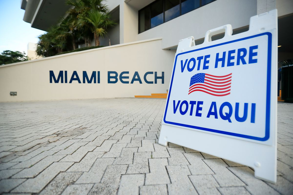 """A """"vote here"""" sign seen in Miami Beach, Florida."""