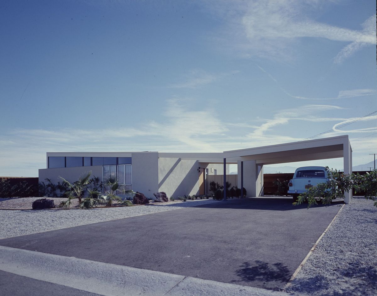 Photo of home with slanted roof and carport