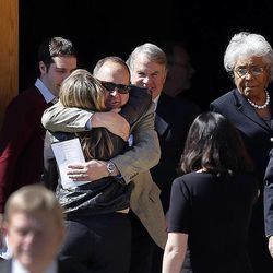 Deedee Corradin's son, Andrew, receives a hug following the memorial service for his mother, former Salt Lake City mayor Deedee Corradini. at Wasatch Presbyterian Church in Salt Lake City, Monday, March 9, 2015.