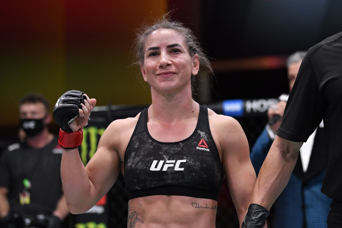 Tecia Torres celebrates her victory over Sam Hughes in their women's strawweight bout during the UFC 256 event at UFC APEX on December 12, 2020 in Las Vegas, Nevada.