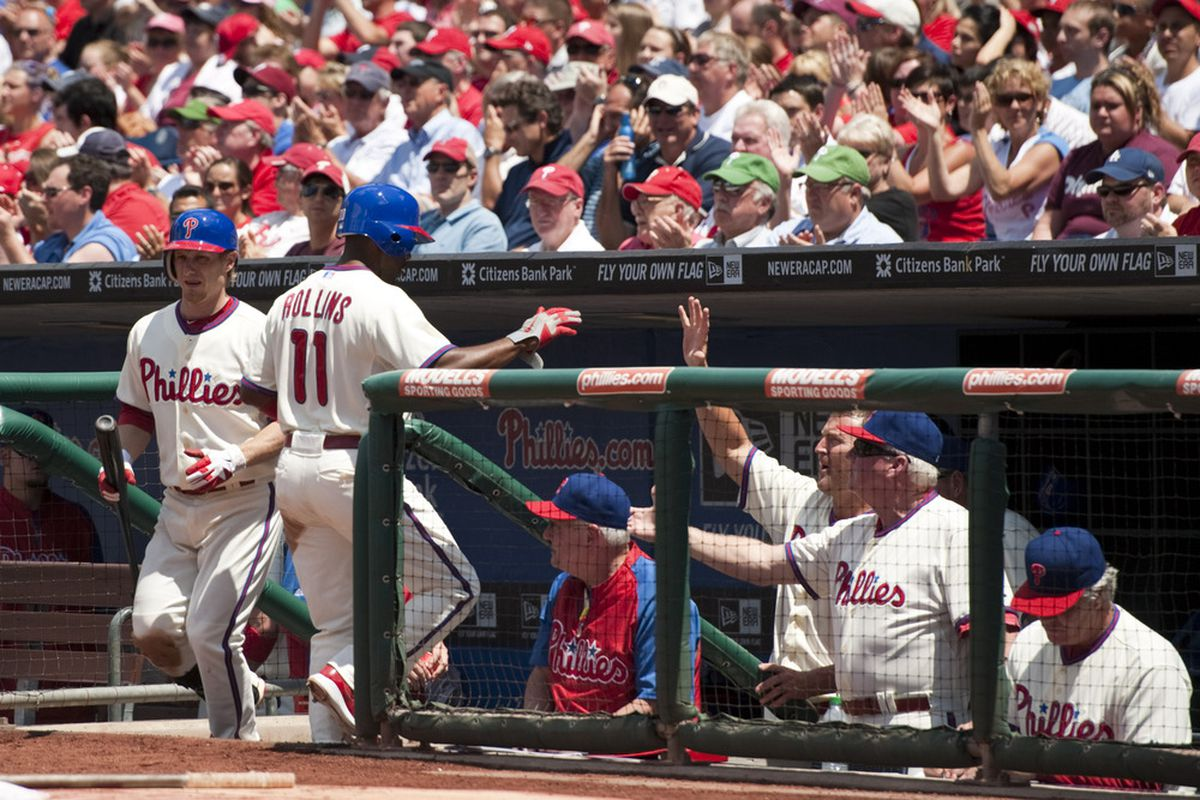 This is the Phillies dugout celebrating in the third inning, i.e. the only inning in which anything good happened for them today. Mandatory Credit: Howard Smith-US PRESSWIRE