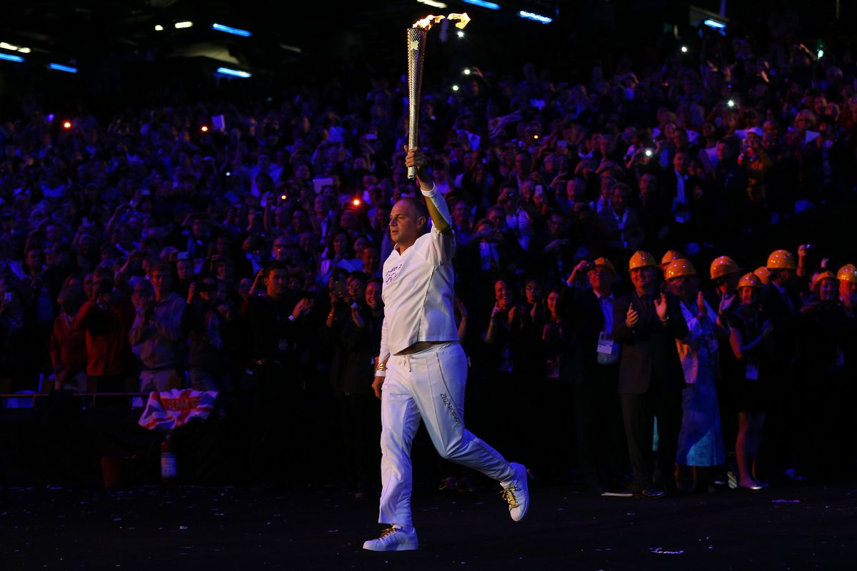 The guy who carried the torch? Five golds in five different Olympics. He was pretty good. (Photo by Cameron Spencer/Getty Images)