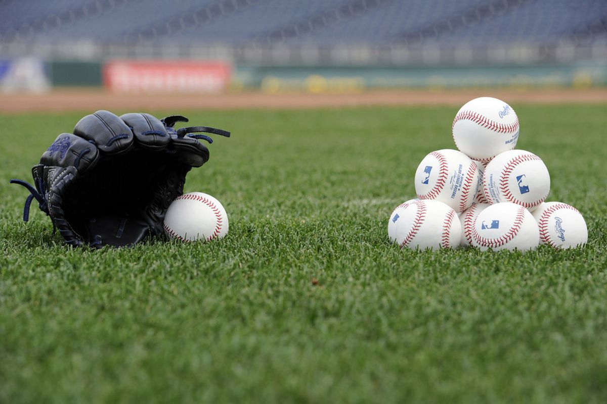 May 4, 2012; Kansas City, MO, USA; A stack of baseballs and a glove before a game between the New York Yankees and the Kansas City Royals at Kauffman Stadium.  Mandatory Credit: Peter G. Aiken-US PRESSWIRE