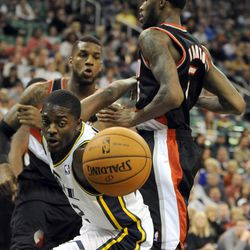 Utah Jazz shooting guard Justin Holiday (22) tries to grab the ball after being fouled from behind by Portland Trail Blazers shooting guard Will Barton (5) in the second half of a game at the Energy Solutions Arena on Wednesday, October 16, 2013.
