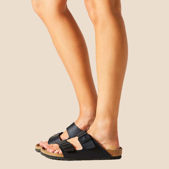 A model wearing Birkenstock sandals.