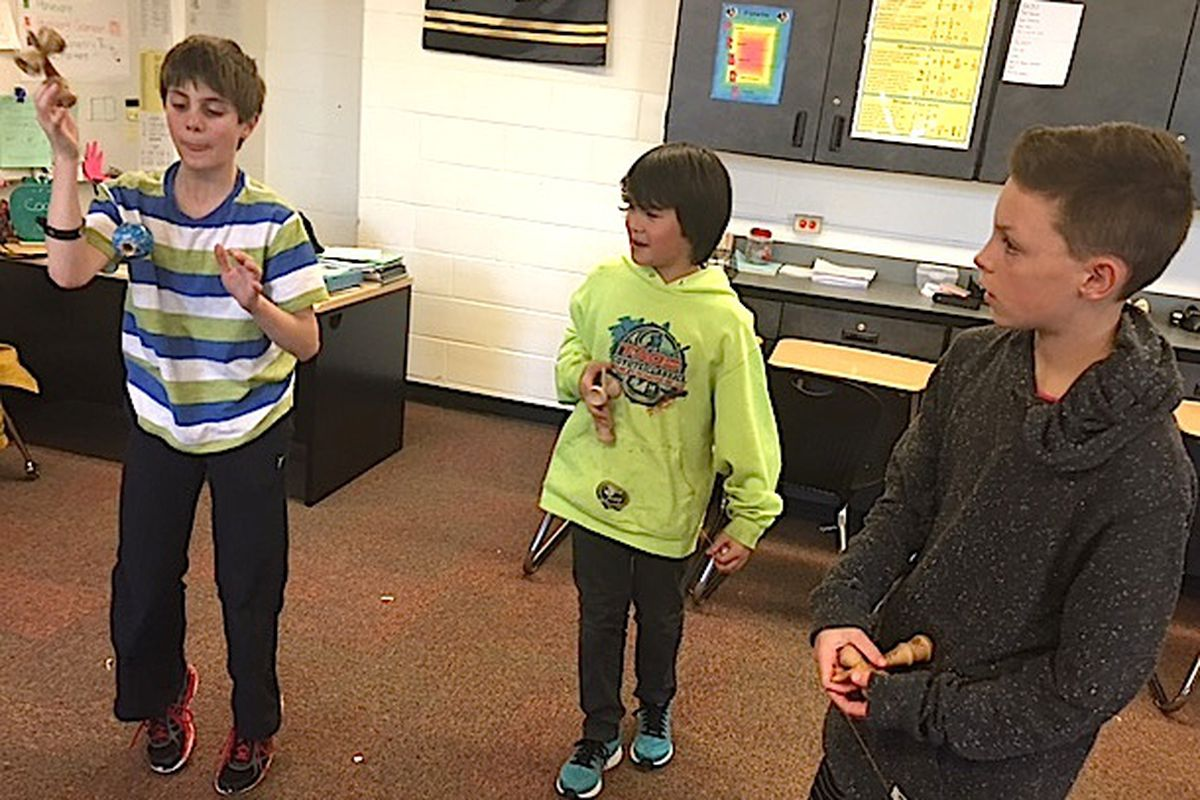 Students practice tricks during a recent Kendama Club meeting at Louisville Middle School