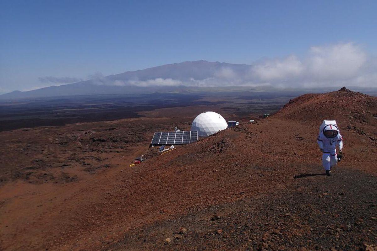 "A Martian ""astronaut,"" part of the HI-SEAS experiment, embarks on an extra-vehicular activity."