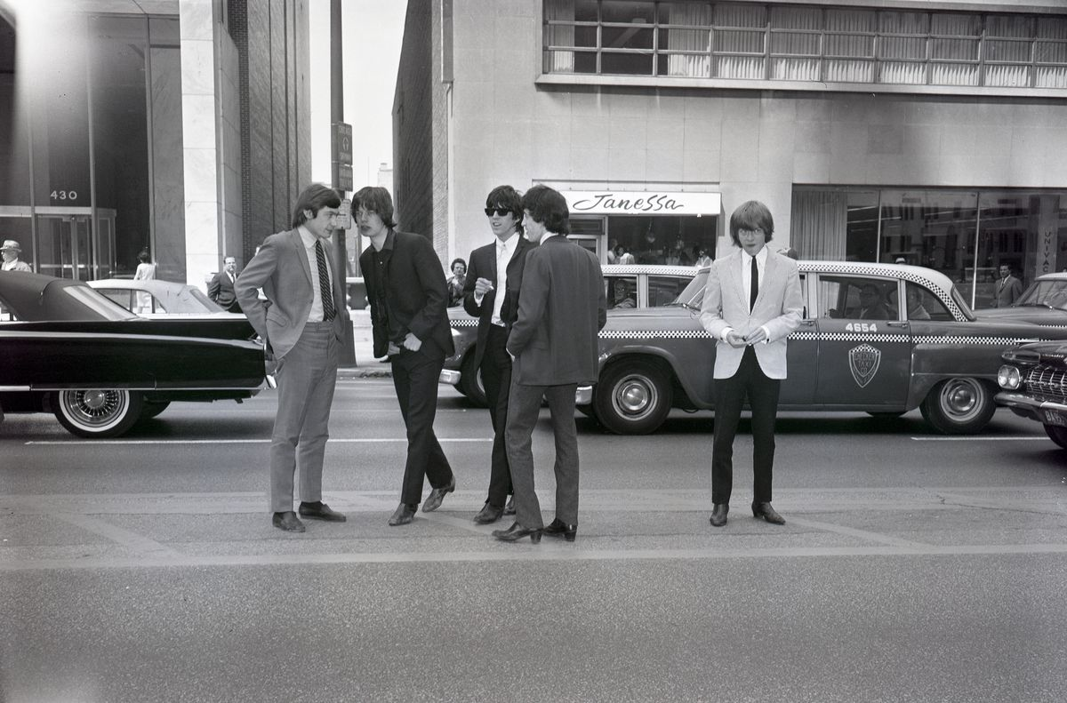 June 11, 1964: Charlie Watts, Mick Jagger, Keith Richards, Bill Wyman and Brian Jones stand in the center of Chicago's Michigan Avenue.   CHICAGO SUN-TIMES FILES