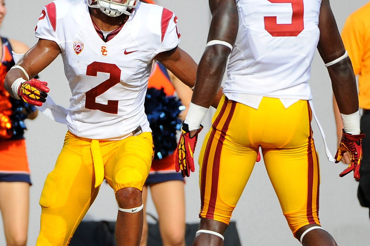 Sep 8, 2012; East Rutherford, NJ, USA; USC Trojans wide receiver Robert Woods (2) celebrates his second quarter touchdown with wide receiver Marqise Lee (9) against the Syracuse Orange at MetLife Stadium.  Mandatory Credit: Rich Barnes-US PRESSWIRE