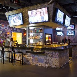 The main bar at Rockhouse. To the right, a pool table made from the front and bed of a junked Ford Ranchero and was featured on Counting Cars.