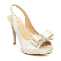 "<b>Kate Spade</b> Glam shoes, <a href=""http://www.katespade.com/designer-shoes/designer-women%27s-heels/glam/S1040489,default,pd.html?dwvar_S1040489_color=101&start=32&cgid=shoes-heels"">$350</a>"