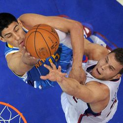 New Orleans Hornets forward Gustavo Ayon, left,  of Mexico and Los Angeles Clippers forward Blake Griffin battle for a rebound during the first half of their NBA basketball game, Sunday, April 22, 2012, in Los Angeles.