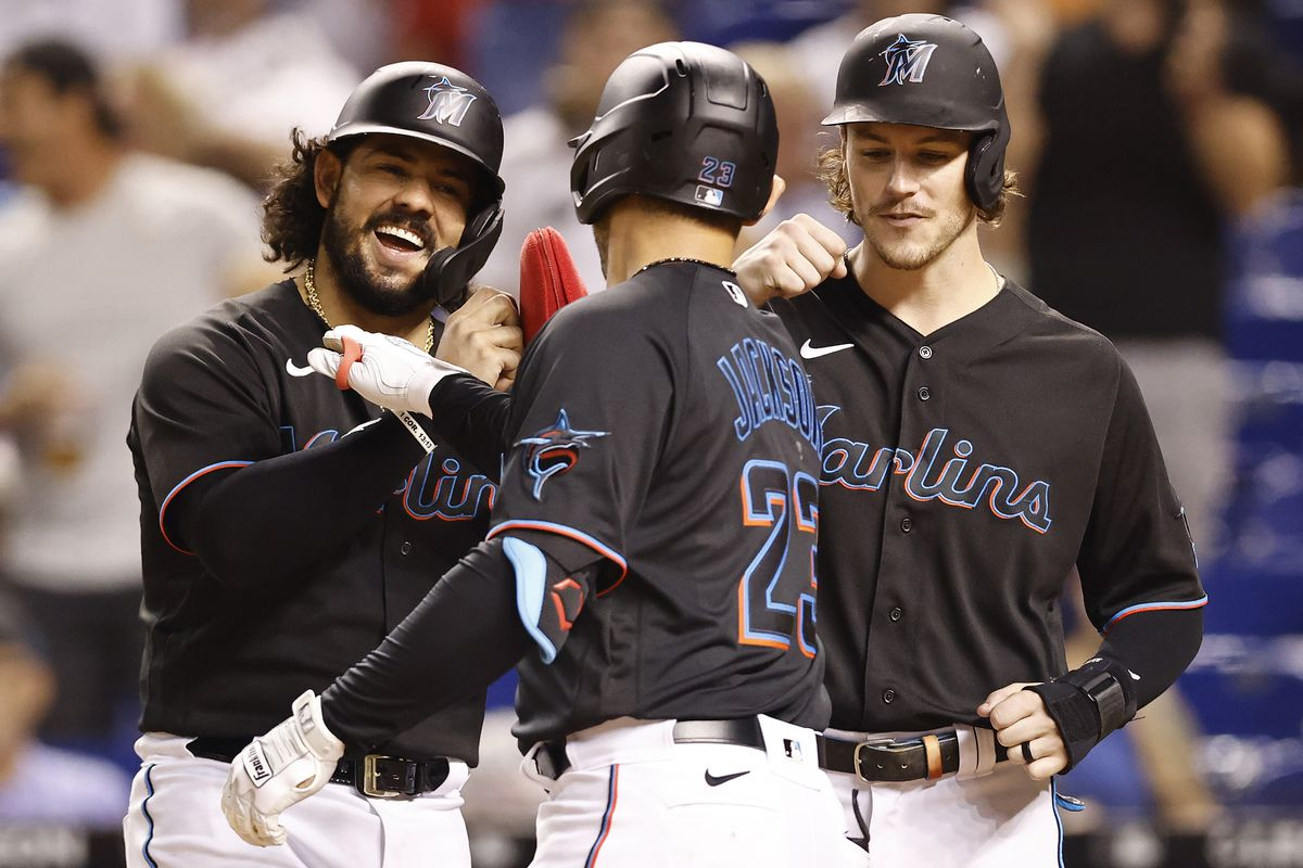 Alex Jackson #23 of the Miami Marlins celebrates his three-run home run with Jorge Alfaro #38 and Brian Anderson #15 during the second inning against the Chicago Cubs at loanDepot park