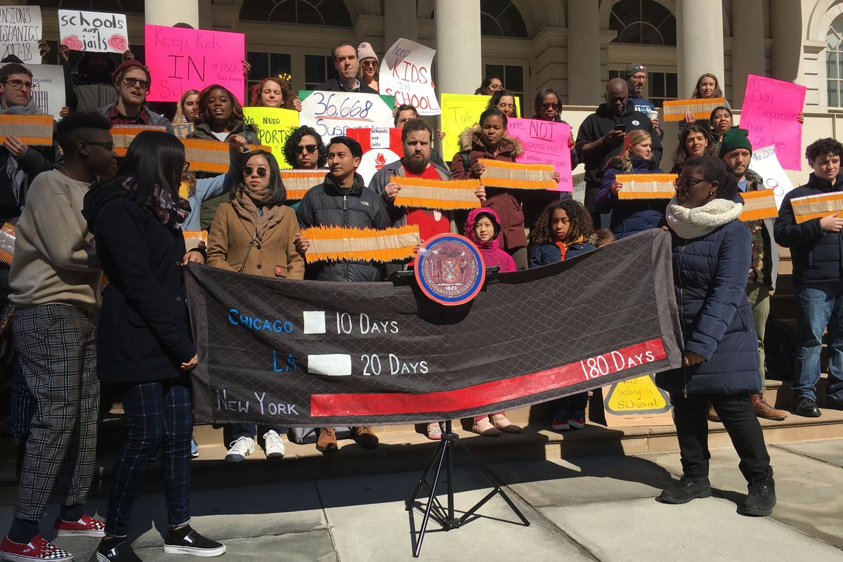 Students protest lengthy suspensions outside City Hall.