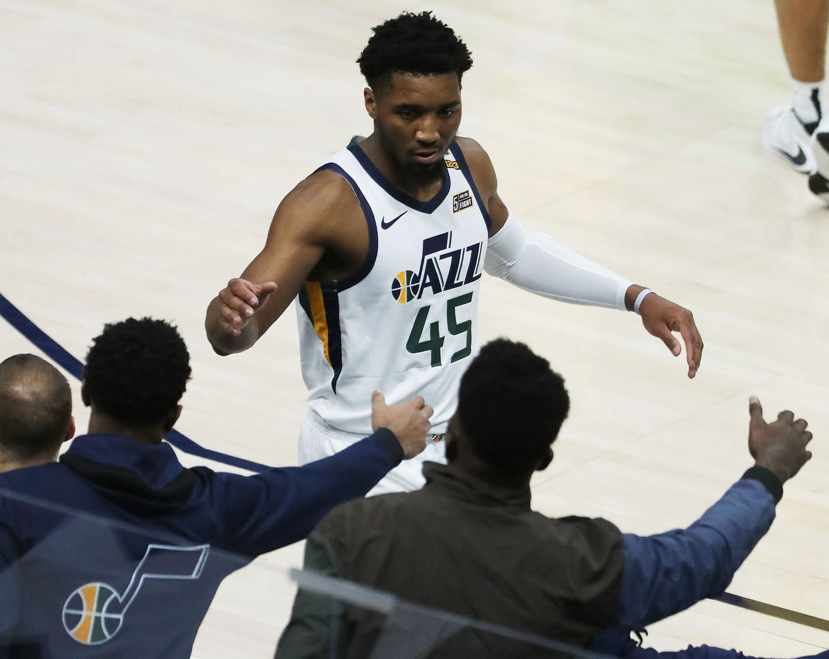 Utah Jazz guard Donovan Mitchell (45) high fives teammates during a game at the Vivint Arena in Salt Lake City on Friday, April 16, 2021.