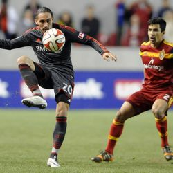 Toronto FC midfielder Issey Nakajima-Farran (20) grabs a loose ball in front of Real Salt Lake defender Tony Beltran (2) during a game at Rio Tinto Stadium in Sandy on Saturday, March 29, 2014.