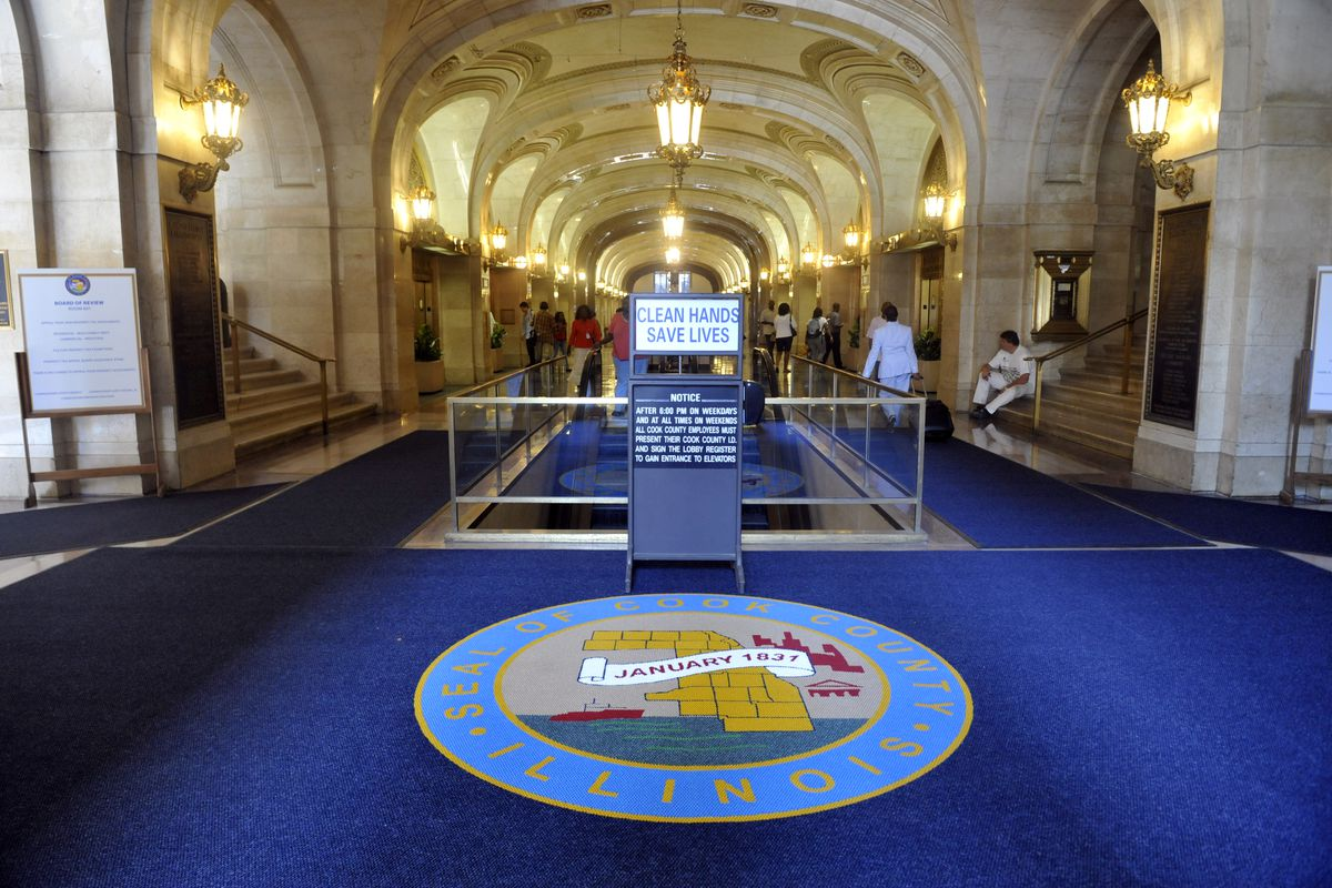 The Cook County Seal on the carpet at the entrance to the County Building 118 N. Clark.