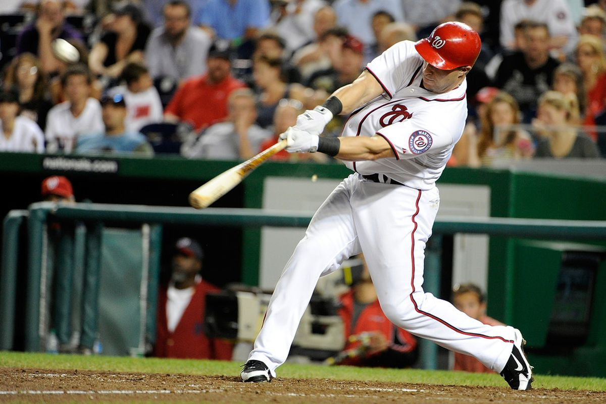 WASHINGTON, DC - AUGUST 24:  Laynce Nix #19 of the Washington Nationals hits a home run in the ninth inning against the Arizona Diamondbacks at Nationals Park on August 24, 2011 in Washington, DC.  (Photo by Greg Fiume/Getty Images)