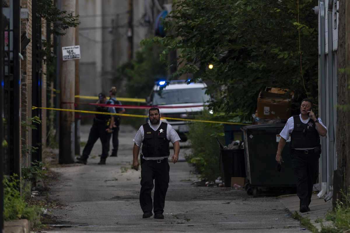 Chicago police investigate the scene where a 9-year-old boy was shot and killed in the 900 block of North Cambridge earlier this month.