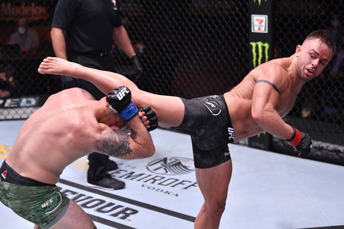Cody Stamman kicks Brian Kelleher in their featherweight bout during the UFC 250 event at UFC APEX on June 06, 2020 in Las Vegas, Nevada.