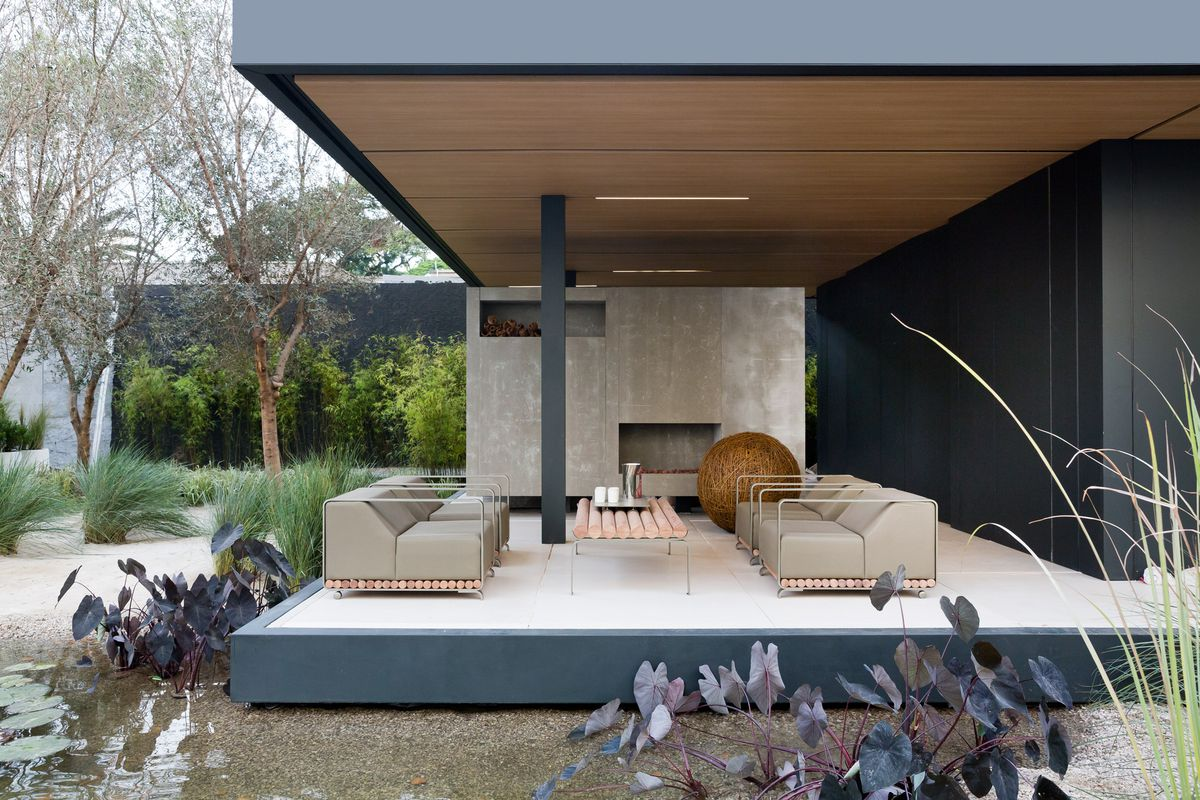 Outdoor patio with concrete fireplace