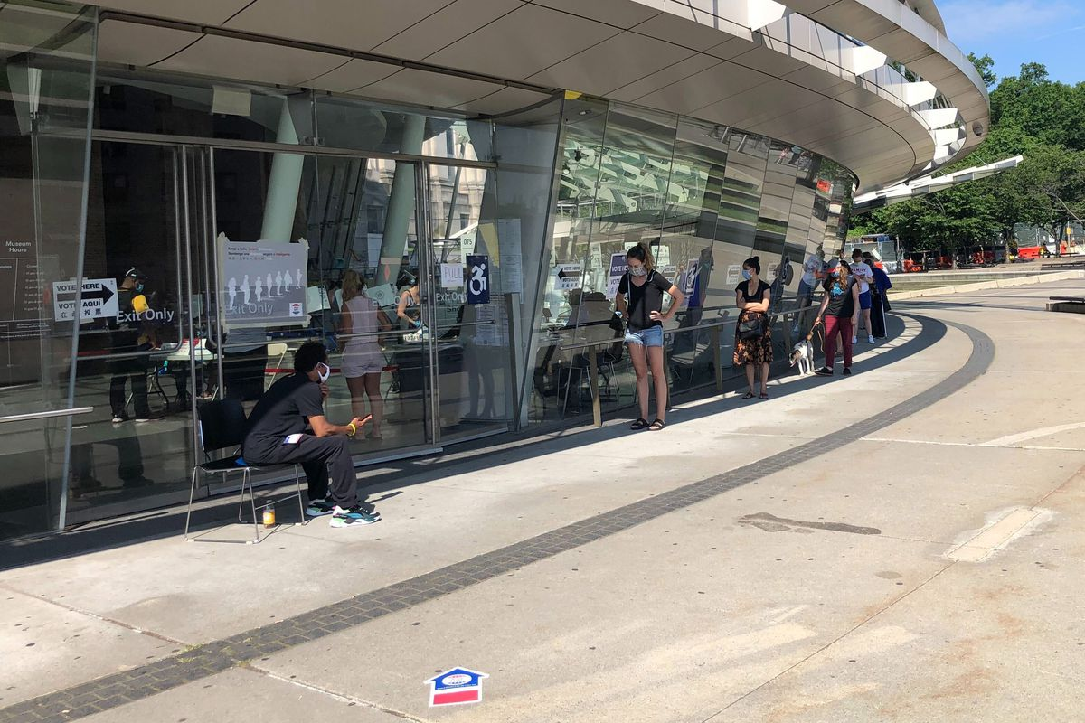 Democratic primary voters wait in line outside a polling site at the Brooklyn Museum, June 23, 2020.