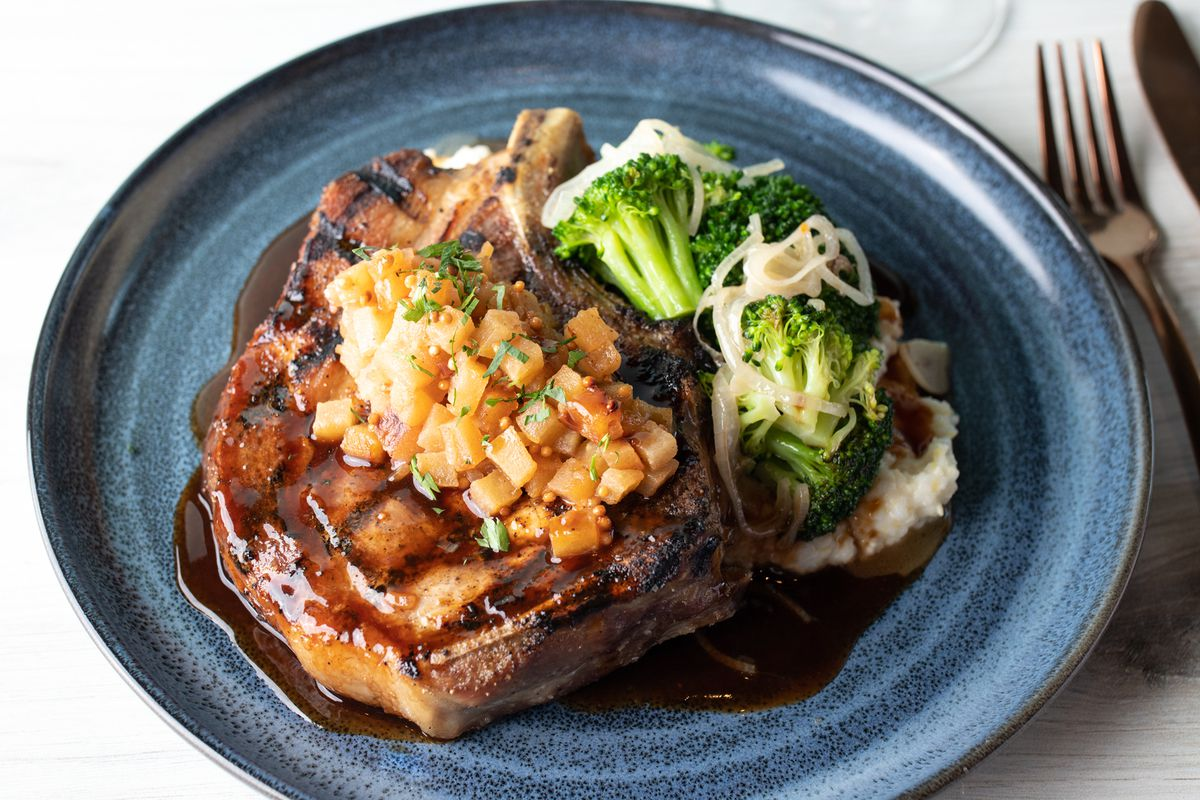 Bone in pork chop with mashed potatoes and broccoli