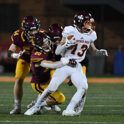 Brother Rice's Dylan Summers (13) tries to spin out of a tackle. Worsom Robinson/For the Sun-Times.