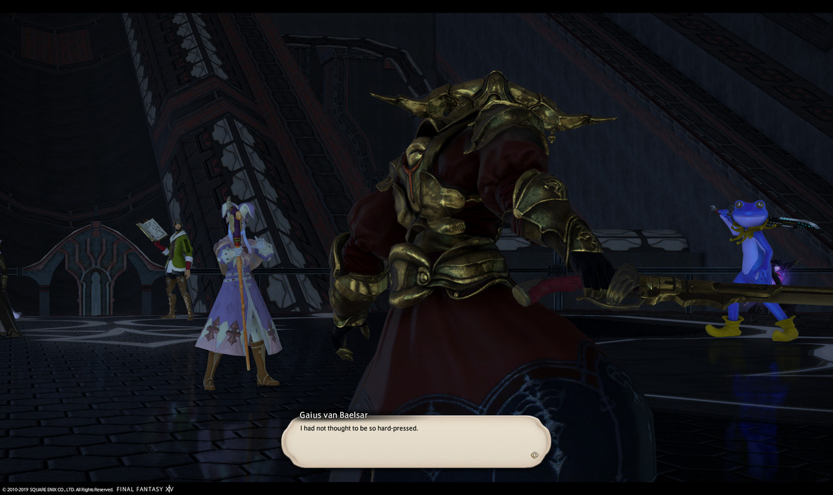 Two appropriately dressed players stand in front of an armored boss, while a character wielding a gunblade in a frog suit sits on the other side