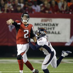 Atlanta Falcons quarterback Matt Ryan (2) throws under pressure from Denver Broncos strong safety Mike Adams (20) during the first half of an NFL football game, Monday, Sept. 17, 2012, in Atlanta.