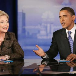 Democratic presidential hopefuls Sen. Hillary Rodham Clinton, D-N.Y., left, and Sen. Barack Obama, D-Ill., respond to a question during a Democratic presidential debate Tuesday, Feb. 26, 2008, in Cleveland, Ohio.