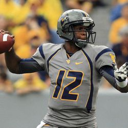 West Virginia quaterback Geno Smith (12) goes to pass during their NCAA college football against Maryland in Morgantown, W.Va. Saturday, Sept. 22, 2012.