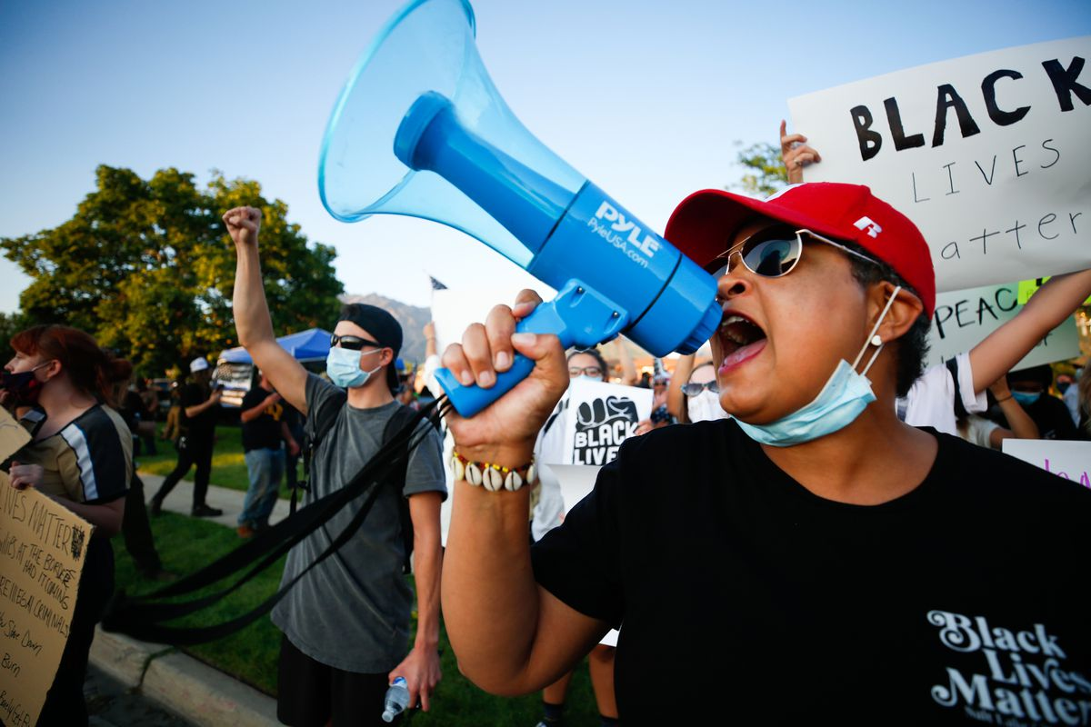 A protester speaks during a protest against police brutality at the Cottonwood Heights Police Department in Cottonwood Heights on Monday, Aug. 3, 2020.