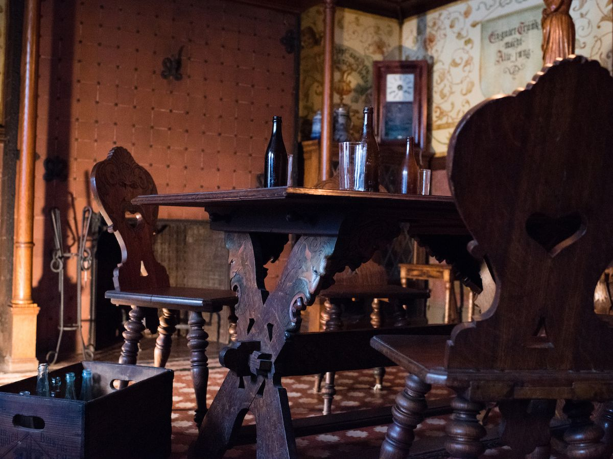 An old table and chairs inside a historic house.