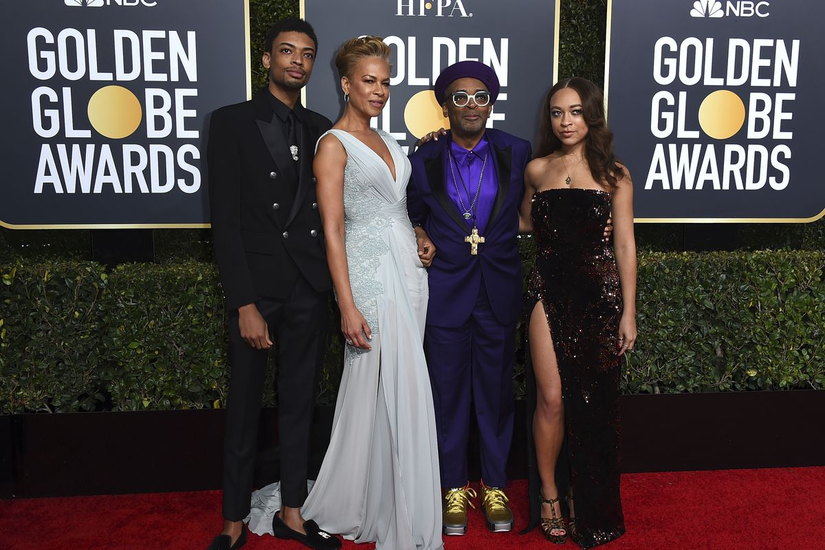 Director Spike Lee is joined by his family, son Jackson Lee (from left), wife Tonya Lewis Lee and daughter Satchel Lee at the 76th annual Golden Globe Awards in 2019.