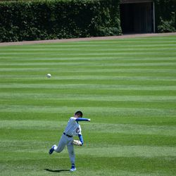12:40 p.m. Coach Brandon Hyde playing catch with his son -