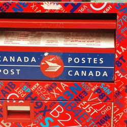 ... or you can put your mail in this colorful (colourful?) box. The letters and numbers are Canadian postal codes