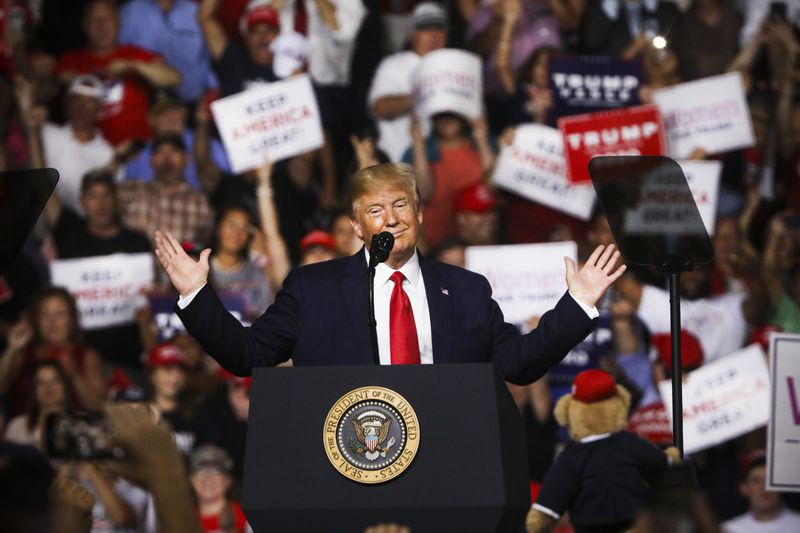 President Trump speaks to supporters at a rally in in Manchester, New Hampshire.